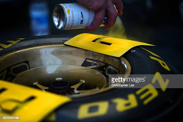 Letters are spraypainted onto Pirelli tyres after practice ahead of the German Grand Prix at Hockenheimring on July 18 2014 in Hockenheim Germany