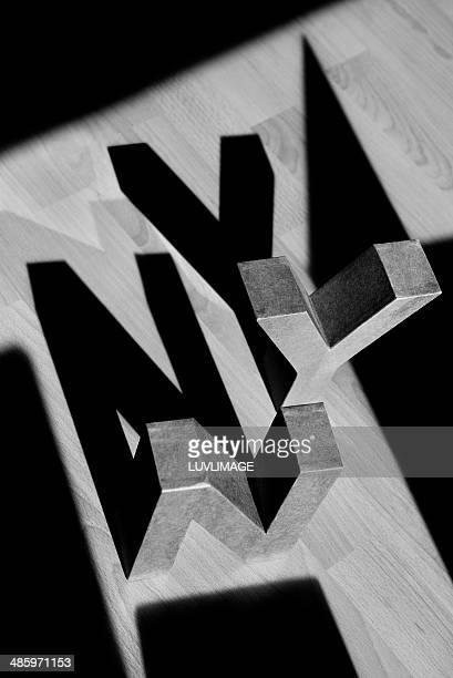 Letters N Y on floor