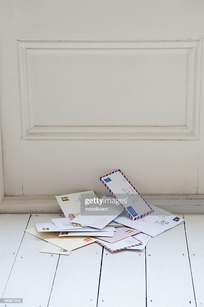 Letters on floorboards at front door : Stock Photo