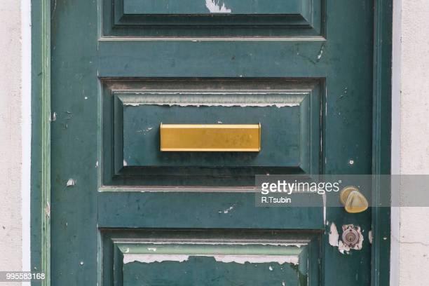 Letters slot at Old Wooden Door in Lisbon, Portugal.