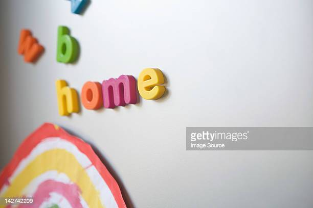Letters spelling home on family refrigerator