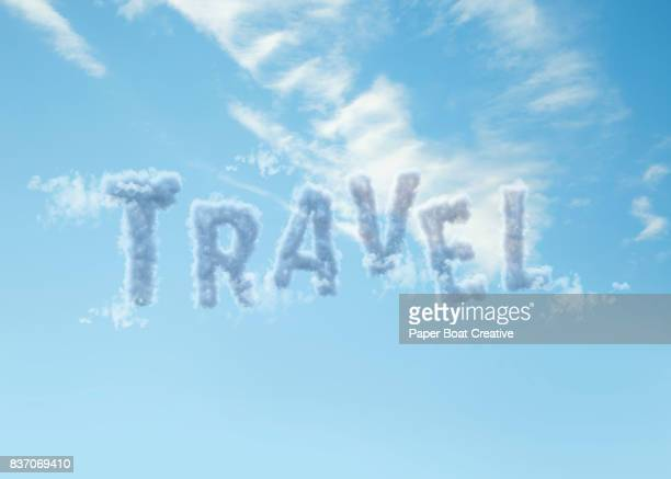 letters t, r, a, v, e, and l shaped from the clouds to look form the word travel and showcased with the blue sky in the background - typographies stock photos and pictures