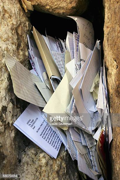 Letters to God are placed between the ancient stones of the Western Wall Judaism's holiest site June 15 2005 in Jerusalem's Old City Israel Every...