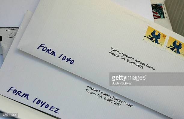 Letters to the Internal Revenue Service are piled up at the US Post Office curbside drop off April 17 2007 in San Francisco California Last minute...