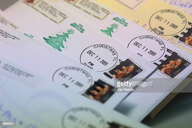 Letters with a Christmas FL postmark sit on a post office counter December 11 2001 in Christmas FL The letters are only a fraction of the thousands...