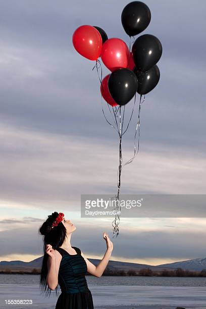 Letting Go of Black and Red Balloons