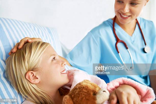 letting her know she's not alone - girl in hospital bed sick stock photos and pictures