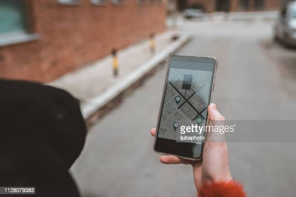 letting her phone lead the way - direction stock pictures, royalty-free photos & images