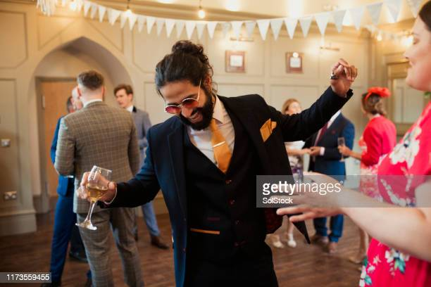 letting loose at a wedding reception - wedding guest stock pictures, royalty-free photos & images