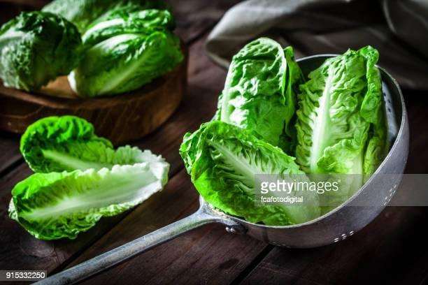 Lettuce hearts in an old metal colander