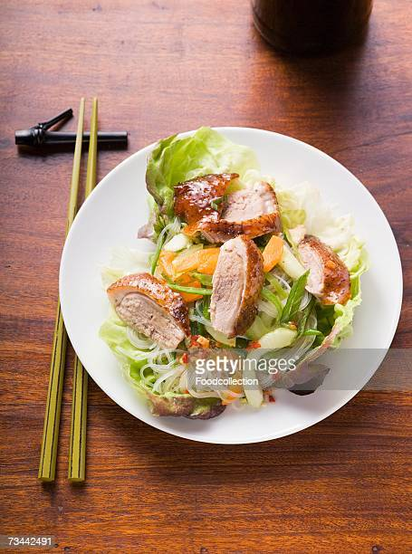 Lettuce with roast duck breast, vegetables, glass noodles (Asia)