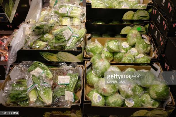 Lettuces packaged in plastic are pictured in a supermarket in north London, on April 27, 2018. - 42 firms, responsible for 80 percent of plastic...