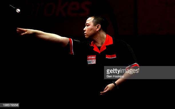 Leung Chun Nam of Hong Kong in action during his first round match on day one of the Ladbrokescom World Darts Championship at Alexandra Palace on...