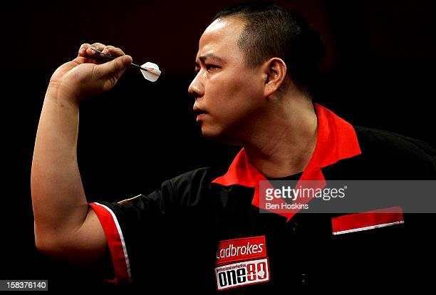 Leung Chun Nam of Hong Kong in action during his preliminary match on day one of the Ladbrokescom World Darts Championship at Alexandra Palace on...