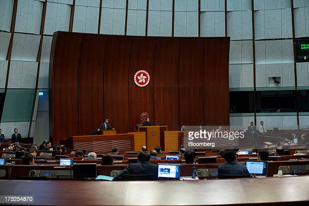 Leung Chunying Hong Kong's chief executive center left speaks during a question and answer session in the chamber of the Legislative Council in Hong...