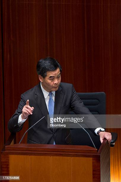 Leung Chunying Hong Kong's chief executive gestures as he speaks during a question and answer session in the chamber of the Legislative Council in...