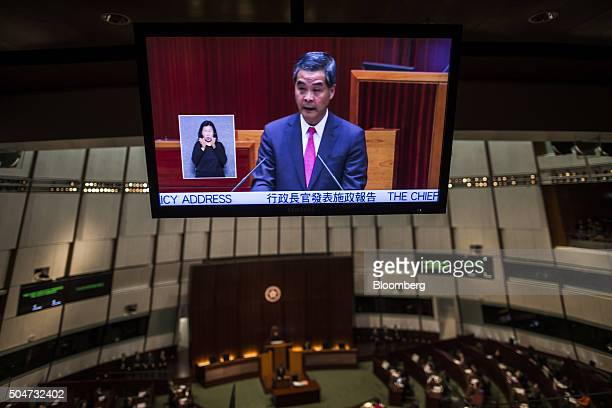 Leung Chunying Hong Kong's chief executive is seen on a television screen as he delivers his policy address in the chamber of the Legislative Council...