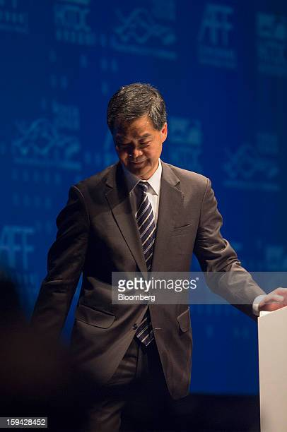 Leung Chunying Hong Kong's chief executive leaves the podium after speaking at the Asian Financial Forum in Hong Kong China on Monday Jan 14 2013...