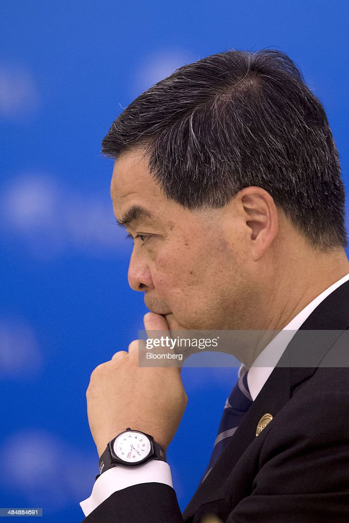Leung Chun-ying, Hong Kong's chief executive, listens during a session at the Boao Forum for Asia in Boao, Hainan, China, on Thursday, April 10, 2014. The Boao Forum for Asia takes place from April 8-11. Photographer: Brent Lewin/Bloomberg via Getty Images