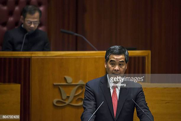 Leung Chunying Hong Kong's chief executive right delivers his policy address in the chamber of the Legislative Council in Hong Kong China on...