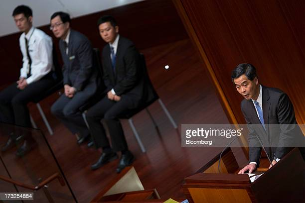 Leung Chunying Hong Kong's chief executive right speaks during a question and answer session in the chamber of the Legislative Council in Hong Kong...