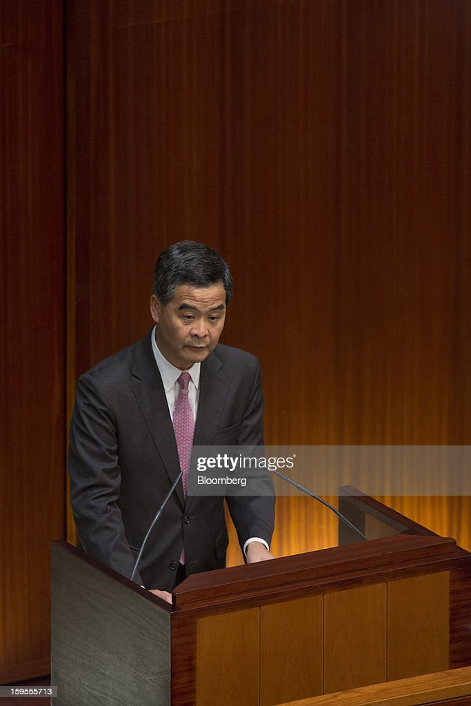 Leung Chun-ying, Hong Kong's chief executive, speaks in the chamber of the Legislative Council in Hong Kong, China, on Wednesday, Jan. 16, 2013. Hong Kong will maintain property curbs for overseas buyers as it seeks to meet the housing needs of its people, Leung said in his first policy address today. Photographer: Jerome Favre/Bloomberg via Getty Images