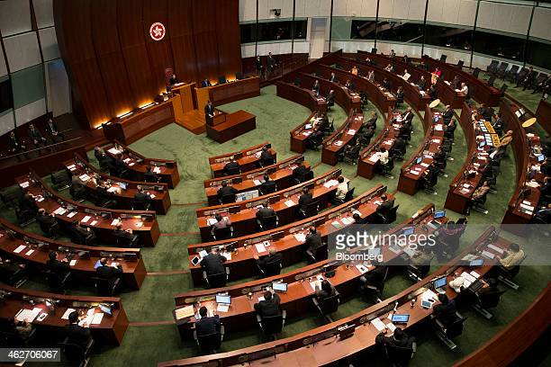 Leung Chunying Hong Kong's chief executive standing at podium speaks during a policy address in the chamber of the Legislative Council in Hong Kong...