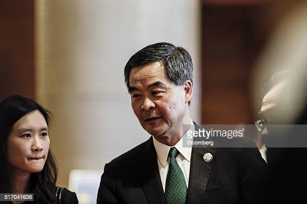 Leung Chunying Hong Kong's chief executive walks through the halls between sessions at the Boao Forum For Asia Annual Conference in Boao China on...