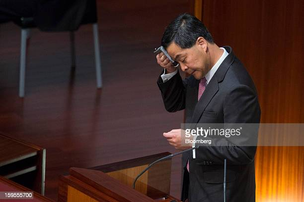 Leung Chunying Hong Kong's chief executive wipes his forehead while speaking in the chamber of the Legislative Council in Hong Kong China on...