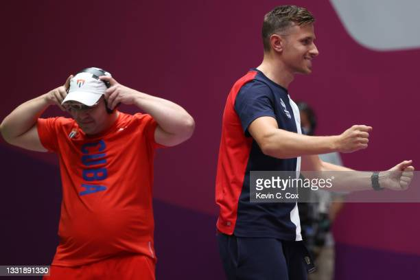 Leuris Pupo of Team Cuba is eliminated to win the Silver Medal, and Jean Quiquampoix of Team France wins the Gold Medal in the 25m Rapid Fire Pistol...