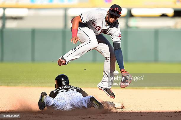 Leury Garcia of the Chicago White Sox beats a tag at second base by Erik Gonzalez of the Cleveland Indians during the ninth inning of a game at US...