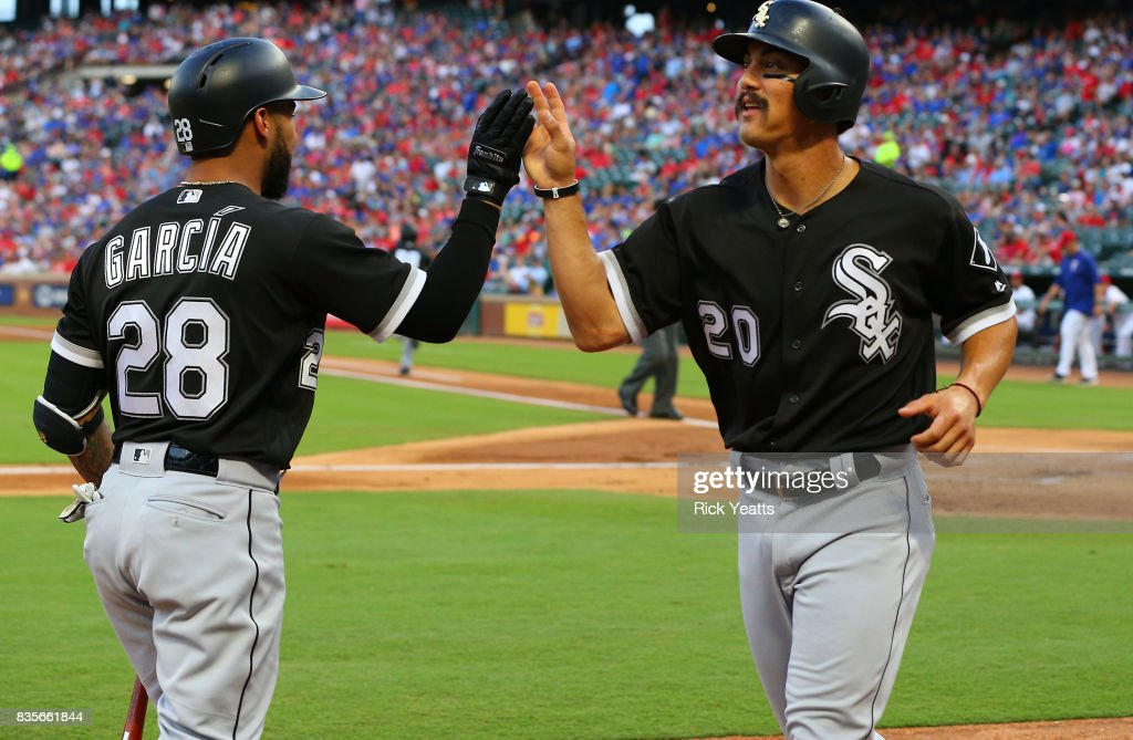 Leury Garcia #28 of the Chicago White Sox congratulates Tyler Saladino #20 for scoring in the first inning against the Texas Rangers at Globe Life Park in Arlington on August 19, 2017 in Arlington, Texas.