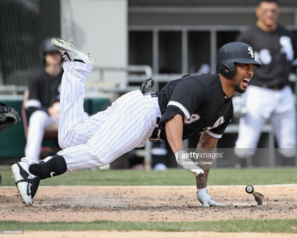 Leury Garcia #28 of the Chicago White Sox hits the ground after being hit on the shin by a pitch in the 7th inning against the Tampa Bay Rays at Guaranteed Rate Field on April 11, 2018 in Chicago, Illinois. The White Sox defeated the Rays 2-1.