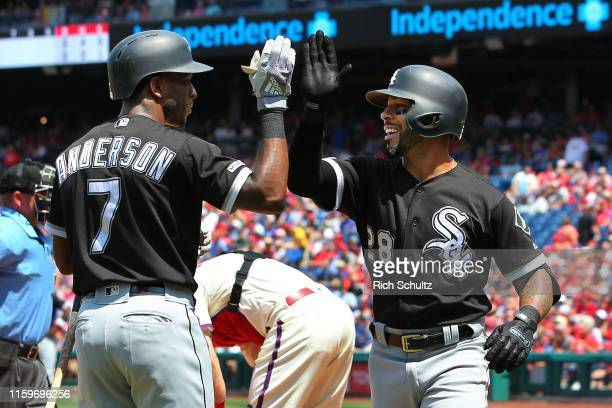 Leury Garcia of the Chicago White Sox is congratulated by Tim Anderson after hitting a grand slam home run against the Philadelphia Phillies during...