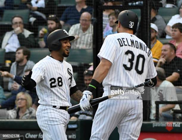 Leury Garcia of the Chicago White Sox is greeted by Nicky Delmonico after scoring against the Pittsburgh Pirates during the first inning on May 8...