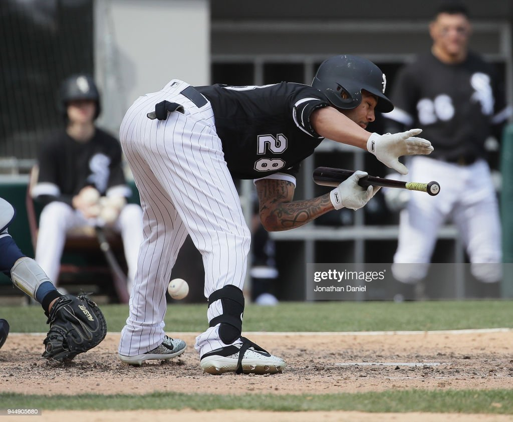 Leury Garcia #28 of the Chicago White Sox is hit on the shin by a pitch in the 7th inning against the Tampa Bay Rays at Guaranteed Rate Field on April 11, 2018 in Chicago, Illinois. The White Sox defeated the Rays 2-1.