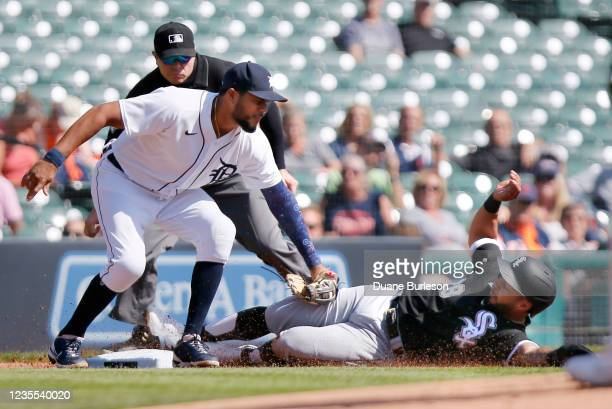 Leury Garcia of the Chicago White Sox is tagged out by third baseman Jeimer Candelario of the Detroit Tigers trying to steal third base during the...