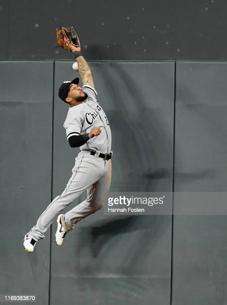 Leury Garcia of the Chicago White Sox is unable to catch a double by Eddie Rosario of the Minnesota Twins in right field during the eighth inning of...
