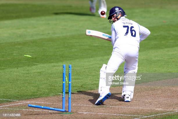 Leus du Plooy of Derbyshire is bowled by Oliver Hannon- Dalby of Warwickshire during day one of the Group One LV Insurance County Championship match...