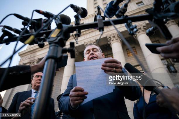 Lev Parnas reads a brief statement to the press as he exits federal court following an arraignment hearing on October 23 2019 in New York City Lev...