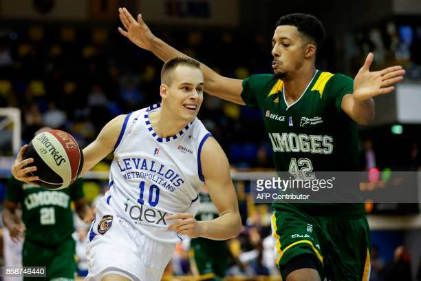 Levallois Metropolitans' shooting guard Slovenia's Klemen Prepelic works around Limoges' forward William Howard during the Pro A basketball match...