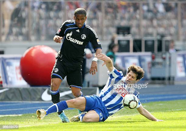 Levan Kobiashvili of Berlin battles for the ball with Jefferson Farfan of Schalke during the Bundesliga match between Hertha BSC Berlin and FC...