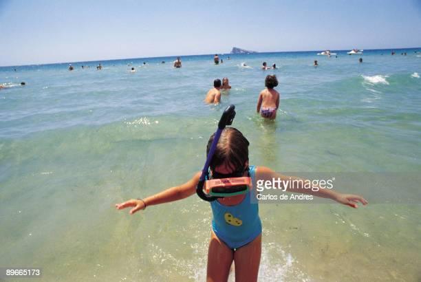 Levante beach Benidorm Alicante A girl with glasses of diving in the beach