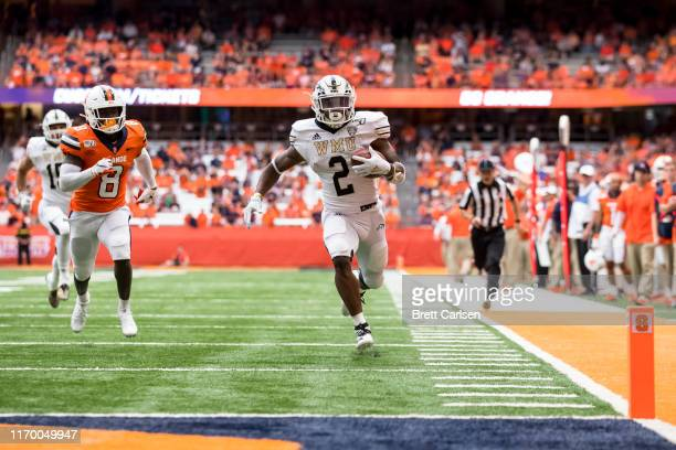 LeVante Bellamy of the Western Michigan Broncos carries the ball for a touchdown during the second quarter against the Syracuse Orange at the Carrier...