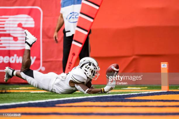 LeVante Bellamy of the Western Michigan Broncos fumbles the ball short of the goal line for a Syracuse Orange touchback during the first quarter at...