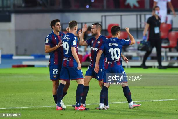 Levante players celebrate after the final whistle during the Liga match between Levante UD and Sevilla FC at Estadio Camilo Cano on June 15, 2020 in...