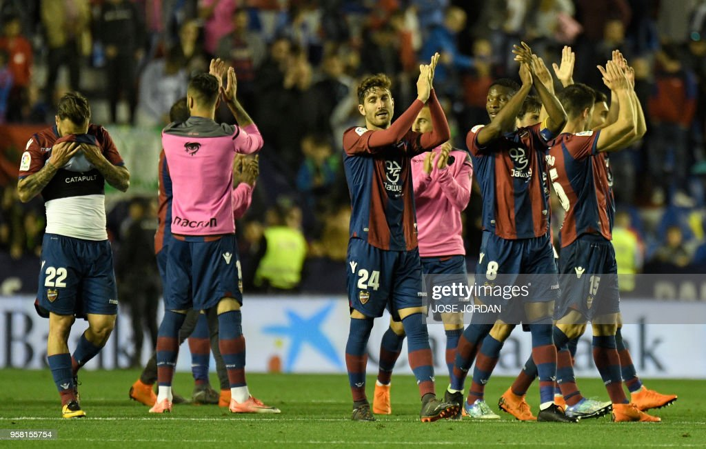 Levante players celebrate at the end of the Spanish league football match between Levante and Barcelona at the Ciutat de Valencia stadium in Valencia on May 13, 2018.