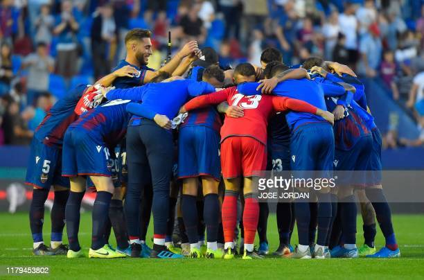Levante players celebrate their win at the end of the Spanish League football match between Levante UD and FC Barcelona at the Ciutat de Valencia...