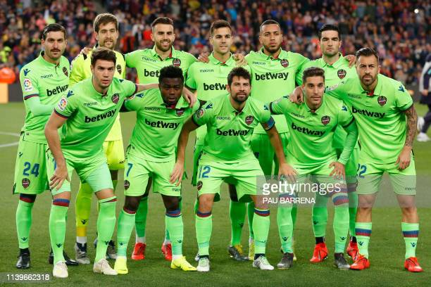 Levante players pose before the Spanish League football match between FC Barcelona and Levante UD at the Camp Nou stadium in Barcelona on April 27...