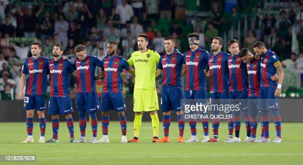 Levante players respect a minute of silence for the bridge disaster in Genova before the Spanish league football match between Real Betis and Levante...